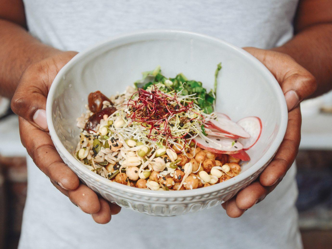 Food + Drink person food dish indoor plate holding meal cuisine hand breakfast produce sense vegetarian food snack food vegetable meat