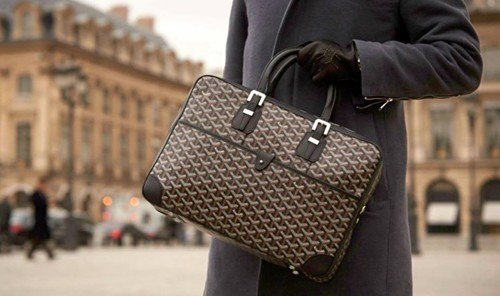 Style + Design outdoor person handbag bag brown pattern fashion accessory Design suit brand textile leather