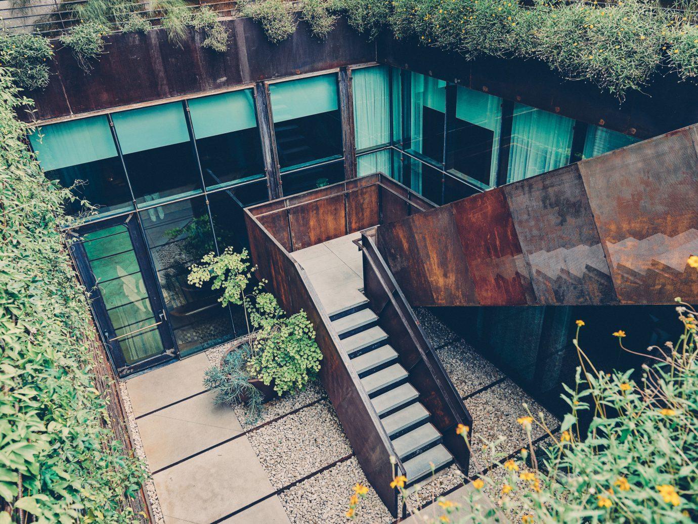 Trip Ideas tree outdoor green house building urban area wall Architecture estate home backyard waterway bridge