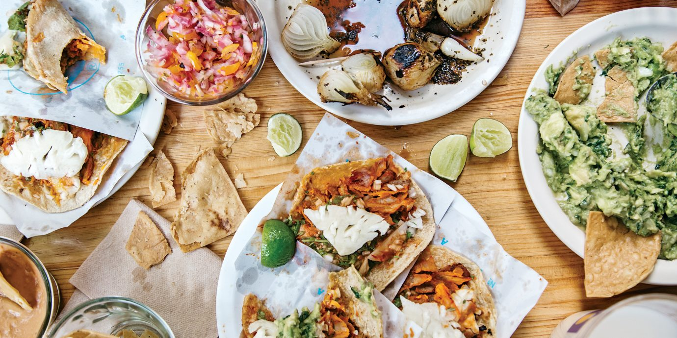 aerial Dining Eat food Food + Drink gourmet Jetsetter Guides local eats Offbeat table tacos Trip Ideas plate dish meal many cuisine different hors d oeuvre wooden Seafood supper lunch several