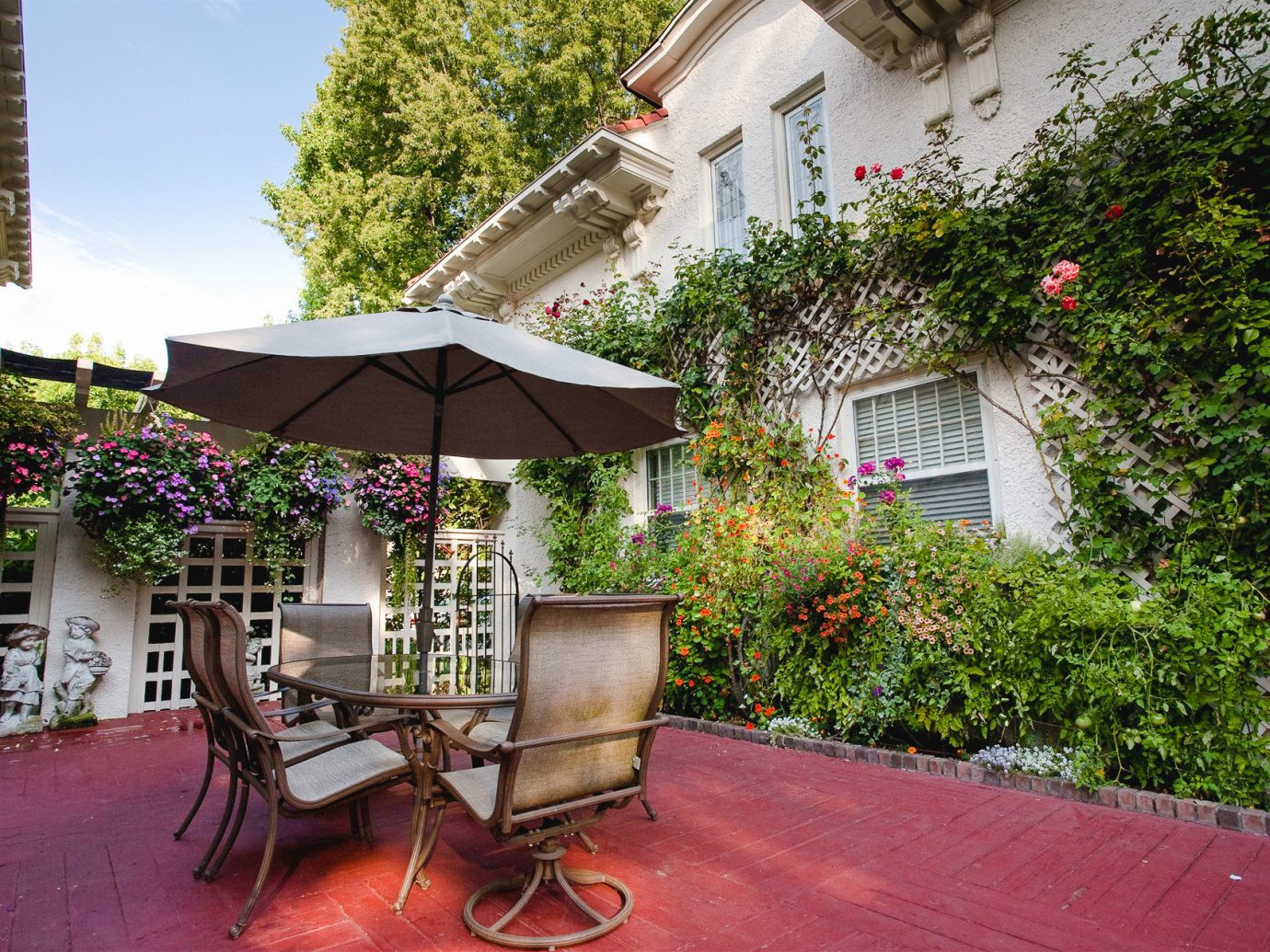 Boutique Hotels Hotels Romantic Getaways Romantic Hotels tree outdoor building property house home Patio real estate Courtyard backyard outdoor structure Balcony plant estate Garden yard cottage apartment stone