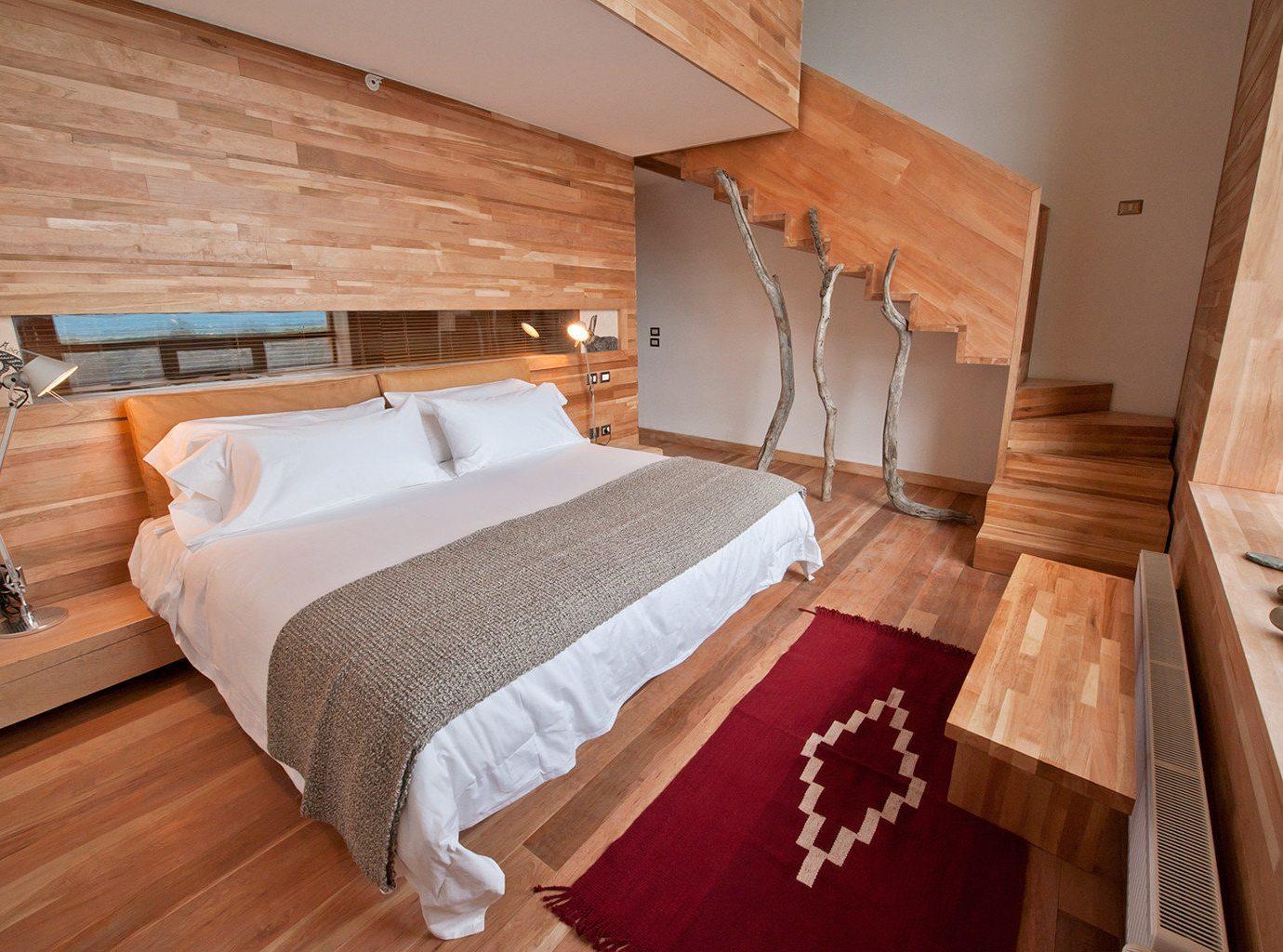 All-Inclusive Resorts Bedroom Elegant Hip Hotels Luxury Modern Romantic Hotels Suite indoor bed floor wall room property cottage hardwood wooden real estate estate apartment wood