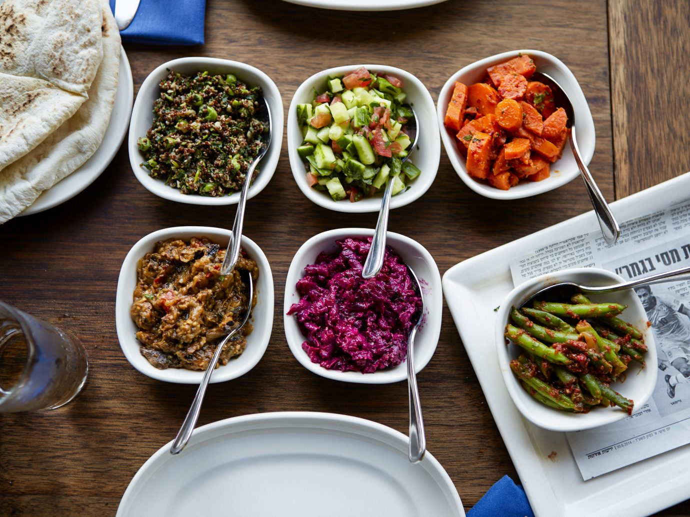 Food + Drink Phildelphia plate food table dish meal cuisine vegetarian food appetizer meze container brunch different vegetable rice condiment lunch recipe breakfast side dish sliced meat several containing arranged