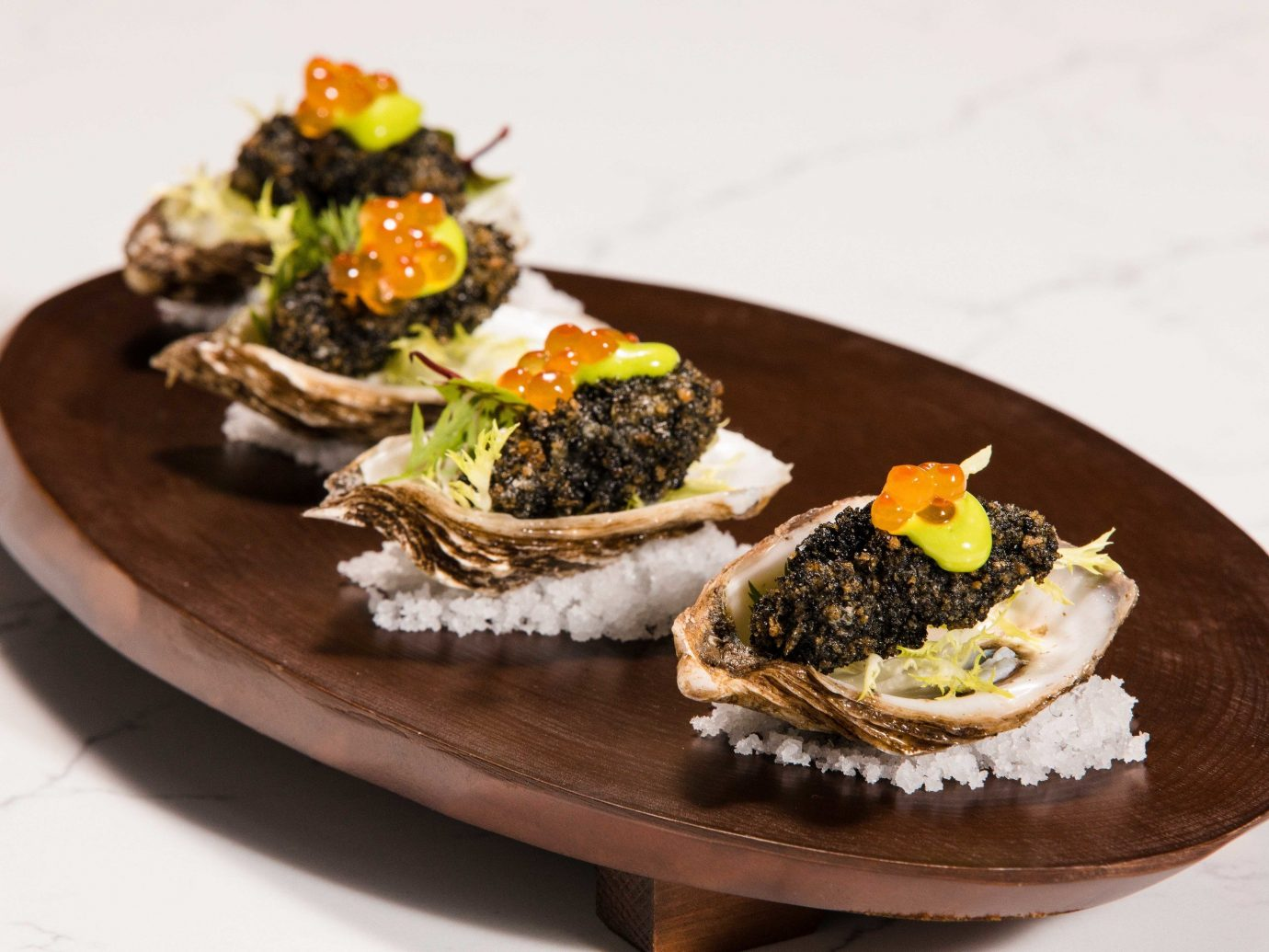 Arts + Culture Food + Drink Hotels Weekend Getaways plate table food dish oysters rockefeller appetizer oyster vegetarian food finger food Seafood sushi dessert recipe animal source foods cuisine clams oysters mussels and scallops sliced