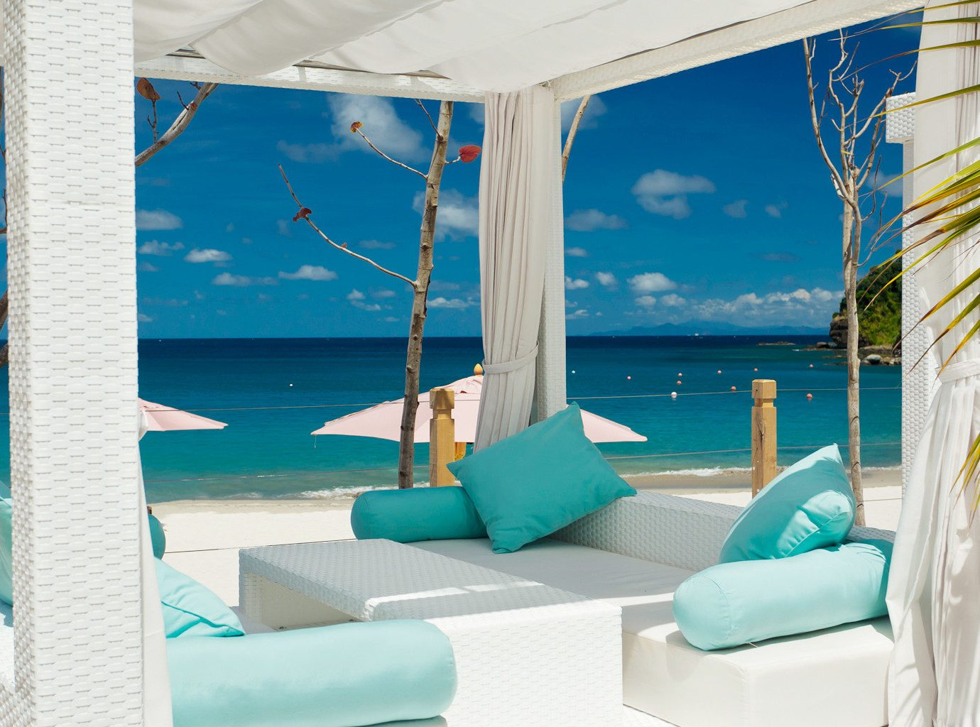 Beach Beachfront Hotels Island Living Wellness blue room chair swimming pool caribbean vacation Resort interior design estate Villa apartment furniture several