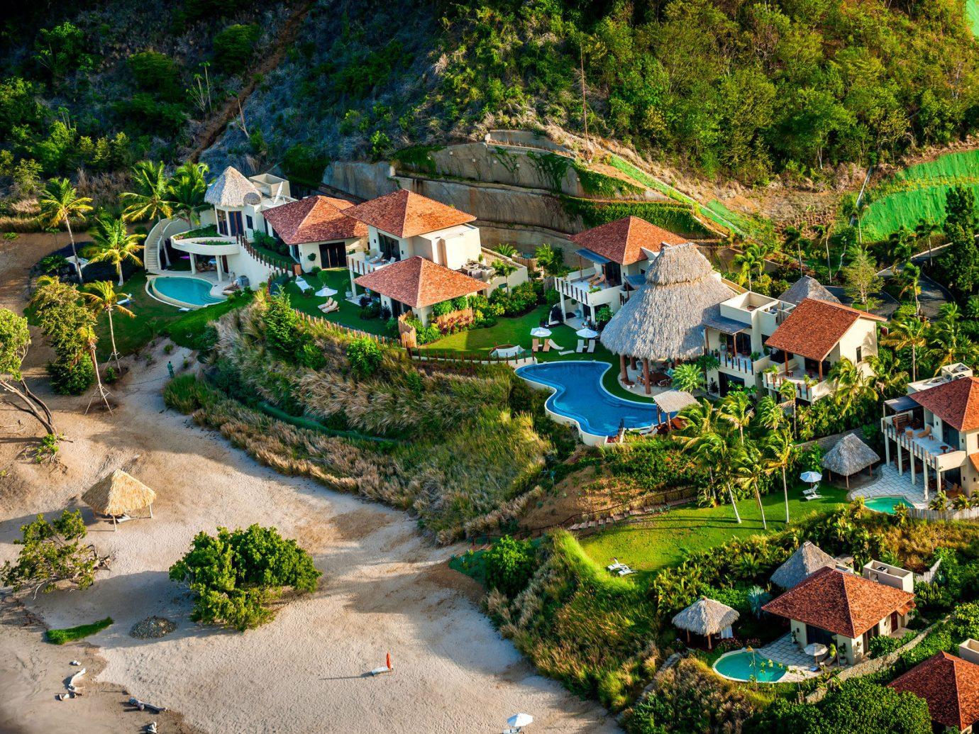 aerial Beach Buildings calm Elegant extravagant fancy isolation Luxury Pool regal remote serene sophisticated Trip Ideas Tropical white sands Winter tree outdoor geographical feature aerial photography Town Village human settlement residential area Nature River estate rural area landscape Resort flower Garden