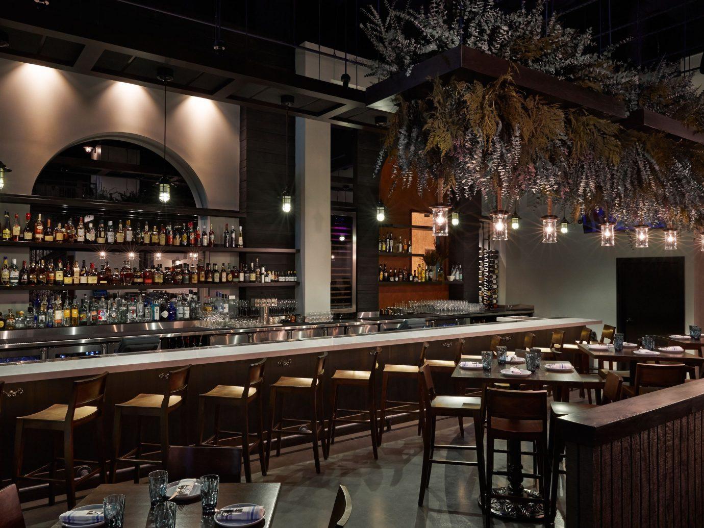 Food + Drink Bar restaurant meal interior design long lined dining room several