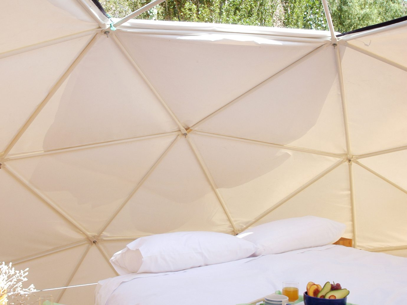Architecture Bedroom Boutique Eco Hotels Lodge Offbeat Romance Rustic Scenic views Suite tree bed property room building furniture cottage tent Villa