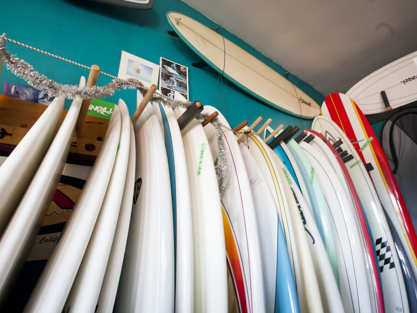 Trip Ideas color blue room indoor different rack bunch surfboard row surfing equipment and supplies electrical wiring interior design lined line several colored arranged variety