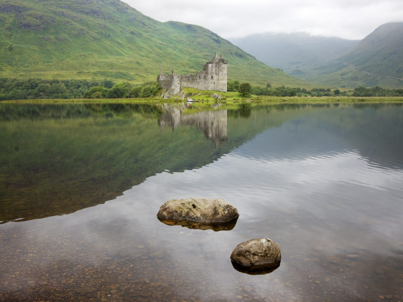 Landmarks Offbeat mountain water sky reflection grass Nature outdoor Lake loch mountainous landforms highland reservoir tarn lake district River morning bank landscape hill tree mount scenery water resources rock cloud fell surrounded