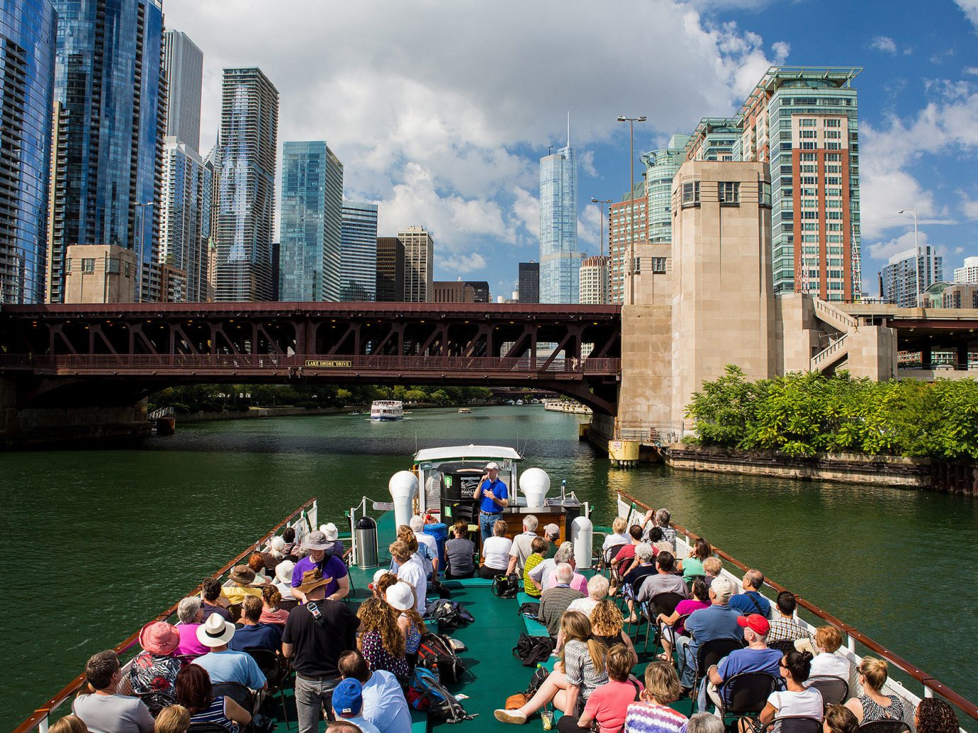 Offbeat water outdoor River Boat scene City vehicle tourism people waterway boating Canal cityscape watercraft skyline tours bridge group travel Lake crowd