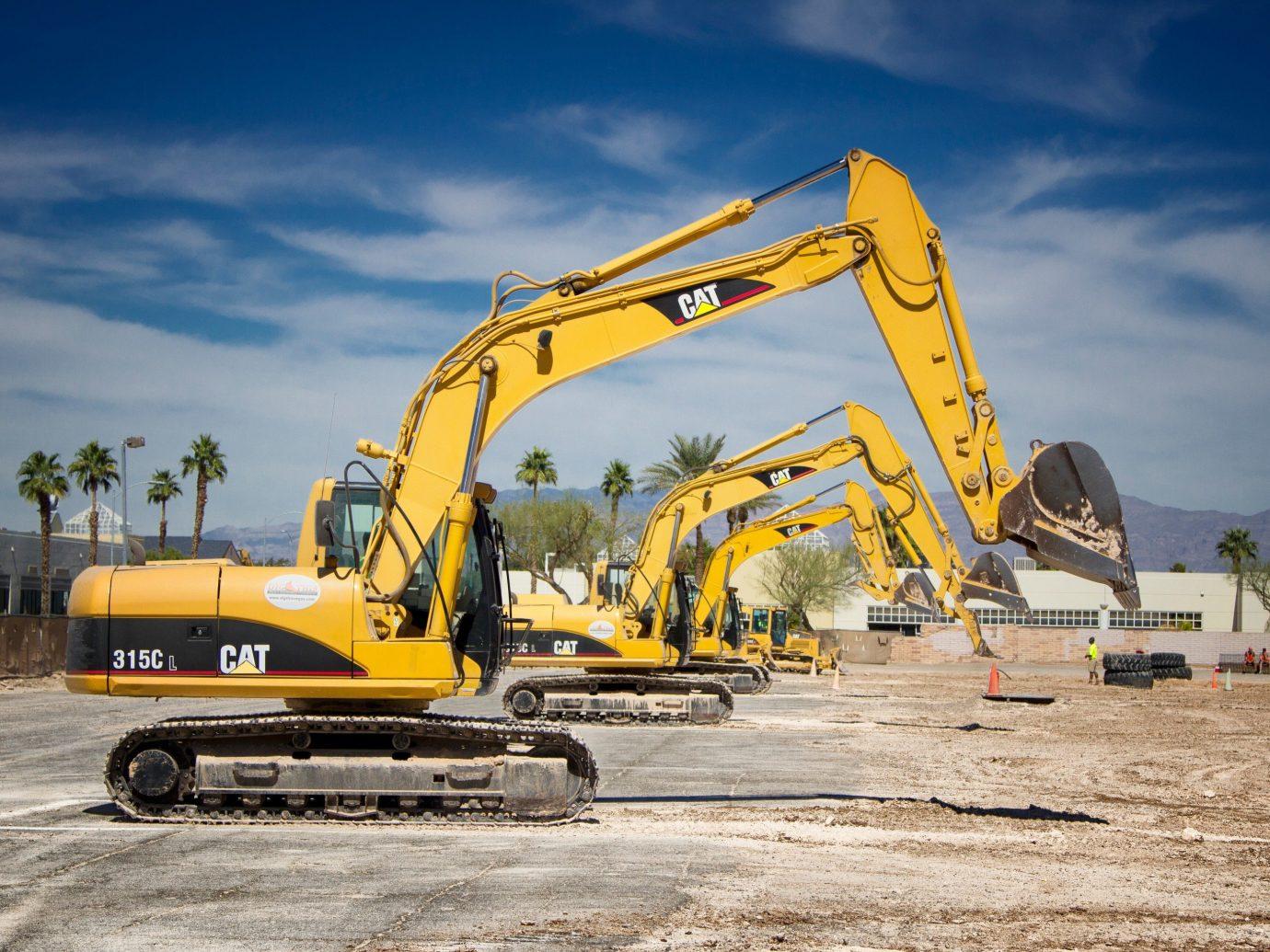 Trip Ideas sky outdoor transport power shovel ground construction equipment demolition yellow vehicle asphalt construction bulldozer