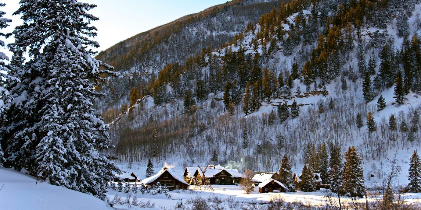 Hotels Trip Ideas outdoor snow tree sky Winter Nature wilderness weather season mountain footwear woody plant Forest mountain range vehicle slope