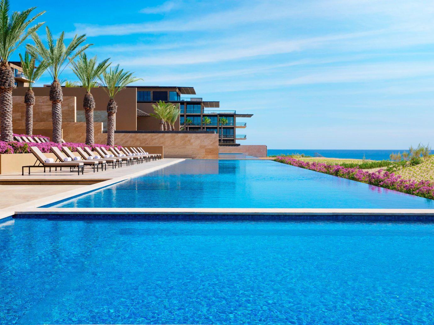 Budget Hotels sky water swimming pool leisure Pool property estate Resort vacation blue reflecting pool Villa Sea condominium bay swimming