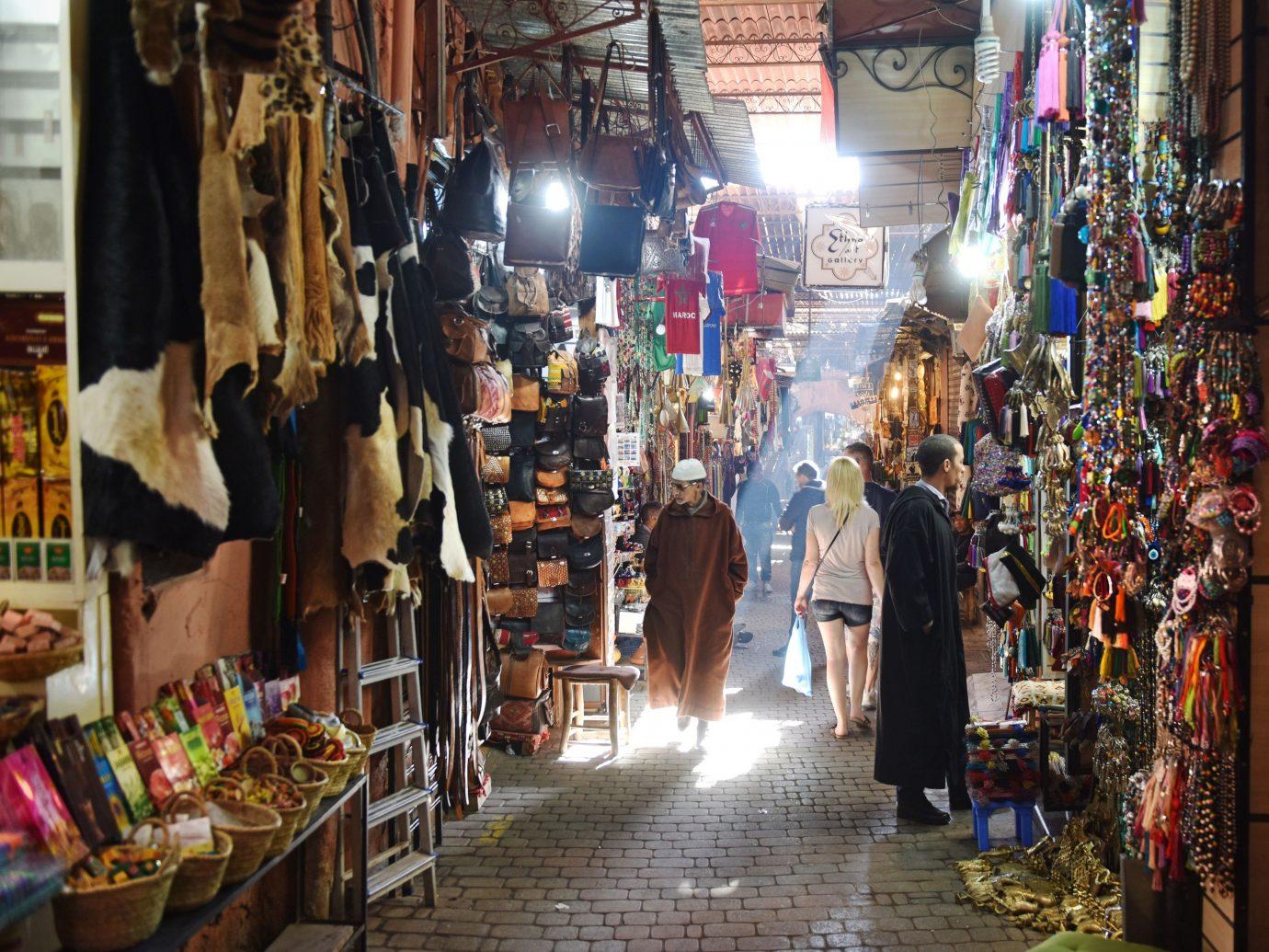 Jetsetter Guides market bazaar marketplace indoor City public space retail scene human settlement Boutique store vendor shopping floristry stall Shop cluttered