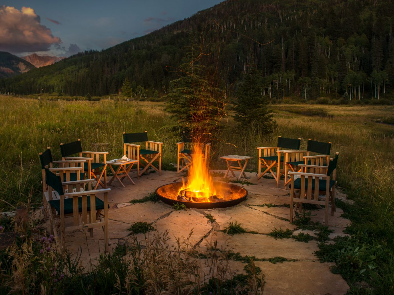 Adventure Country Forest Glamping Grounds Mountains Outdoors + Adventure Rustic Weekend Getaways Wellness outdoor grass sky mountain wilderness yellow morning Nature evening reflection park campfire fire autumn surrounded