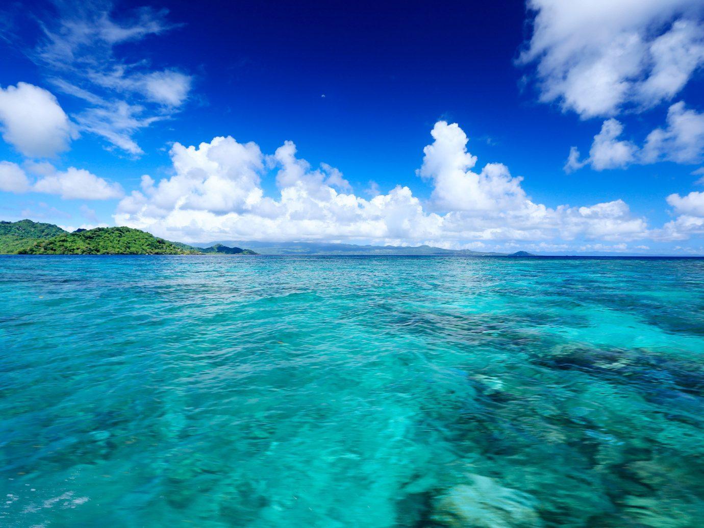 Islands Trip Ideas sky water outdoor Sea Ocean blue horizon wind wave cloud Nature Coast shore caribbean clouds Lagoon wave islet cape Island bay cloudy reef day