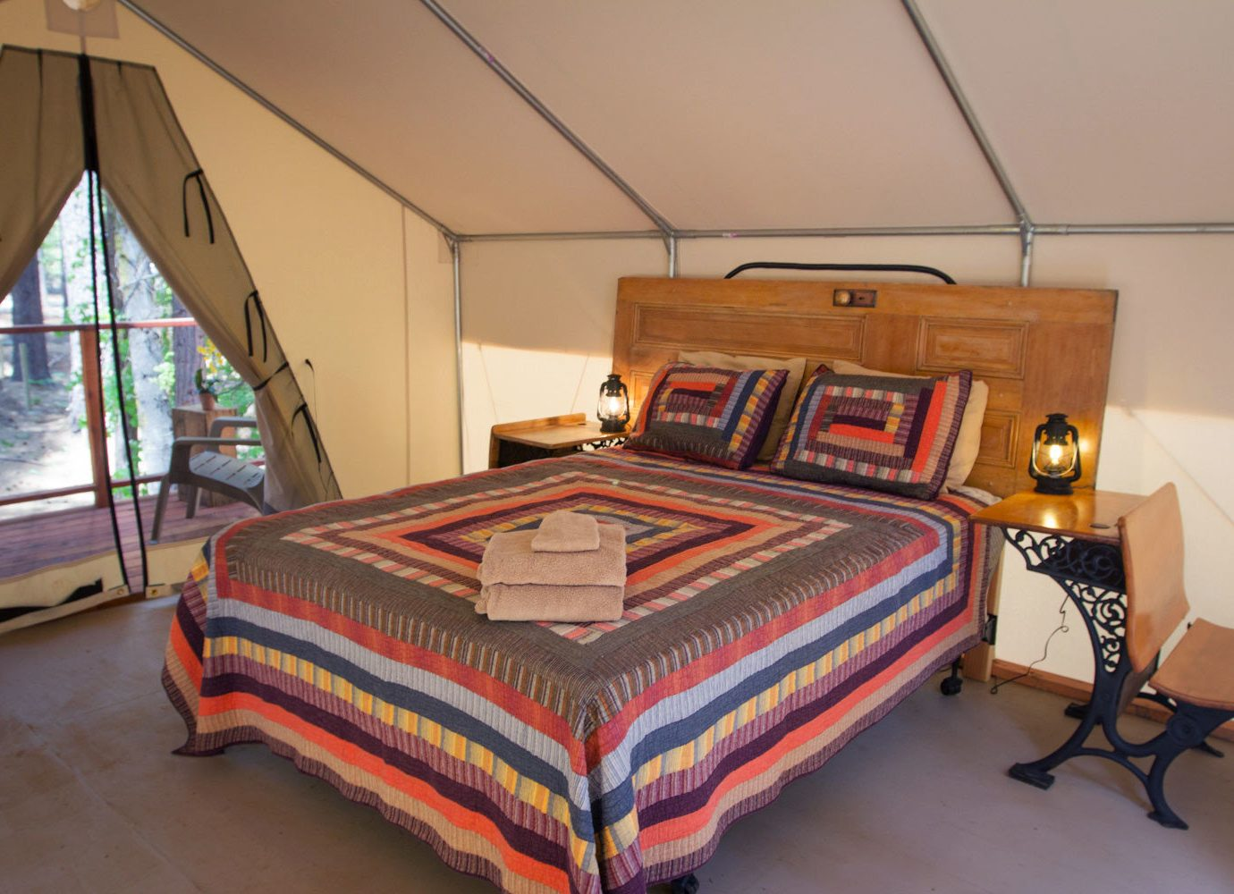 Glamping Luxury Travel Outdoors + Adventure floor indoor wall room Bedroom property bed furniture bed sheet cottage interior design