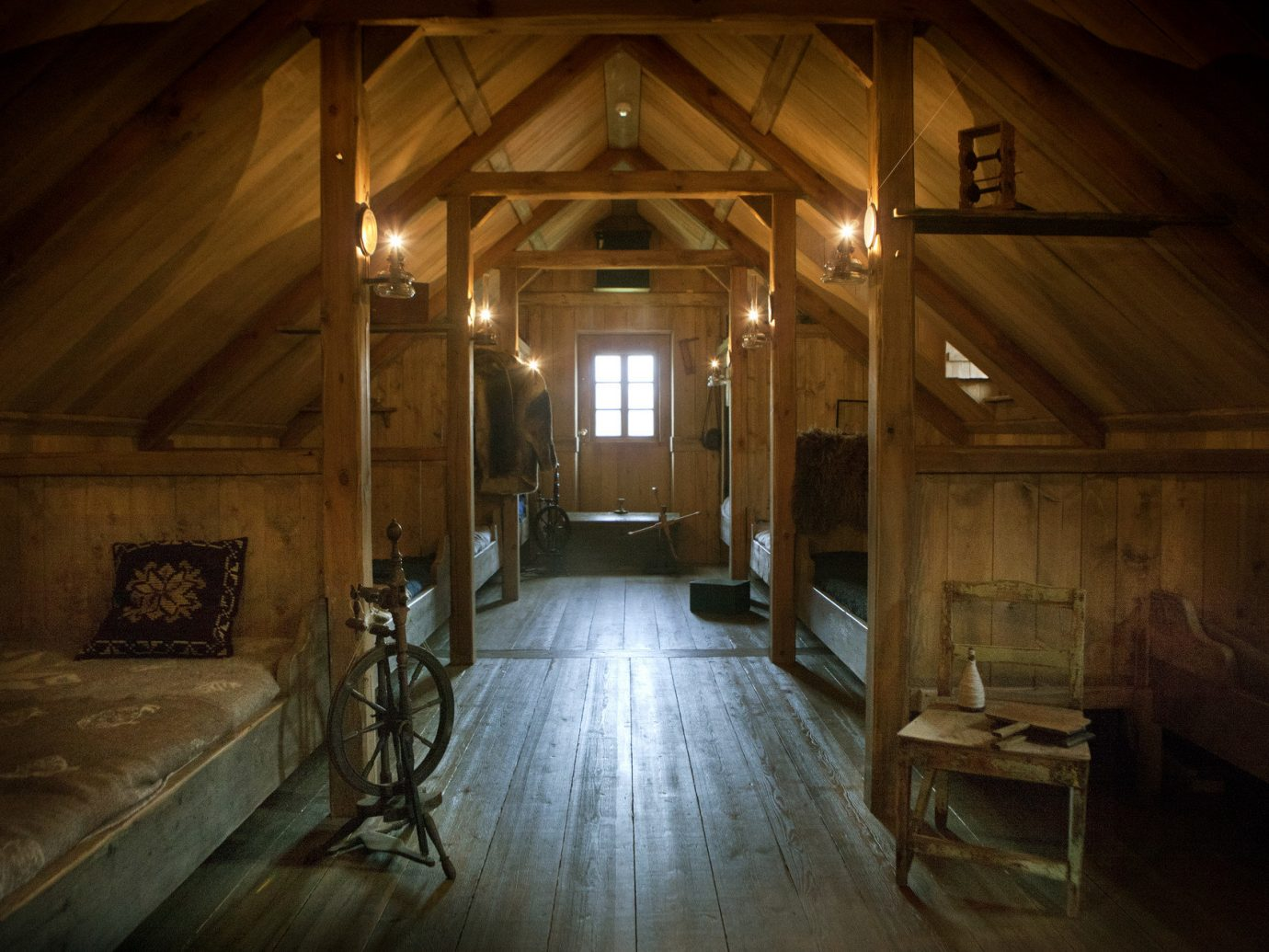 ambient lighting attic bed charming cozy exhibit Historic homey interior living area natural light Offbeat Rustic vintage window indoor floor building room house ceiling estate wood lighting barn interior design home cottage farmhouse log cabin hall stone