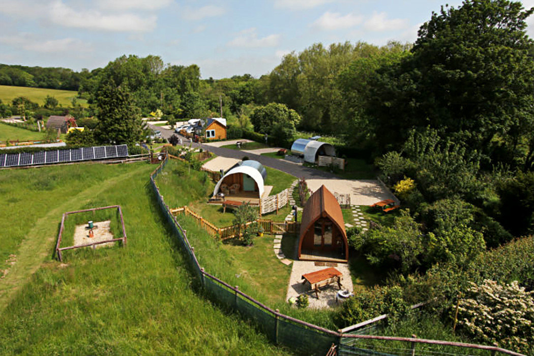 Glamping Outdoors + Adventure Trip Ideas tree grass outdoor sky Farm rural area plant Village land lot aerial photography landscape camping recreation car bird's eye view meadow field lush traveling Garden