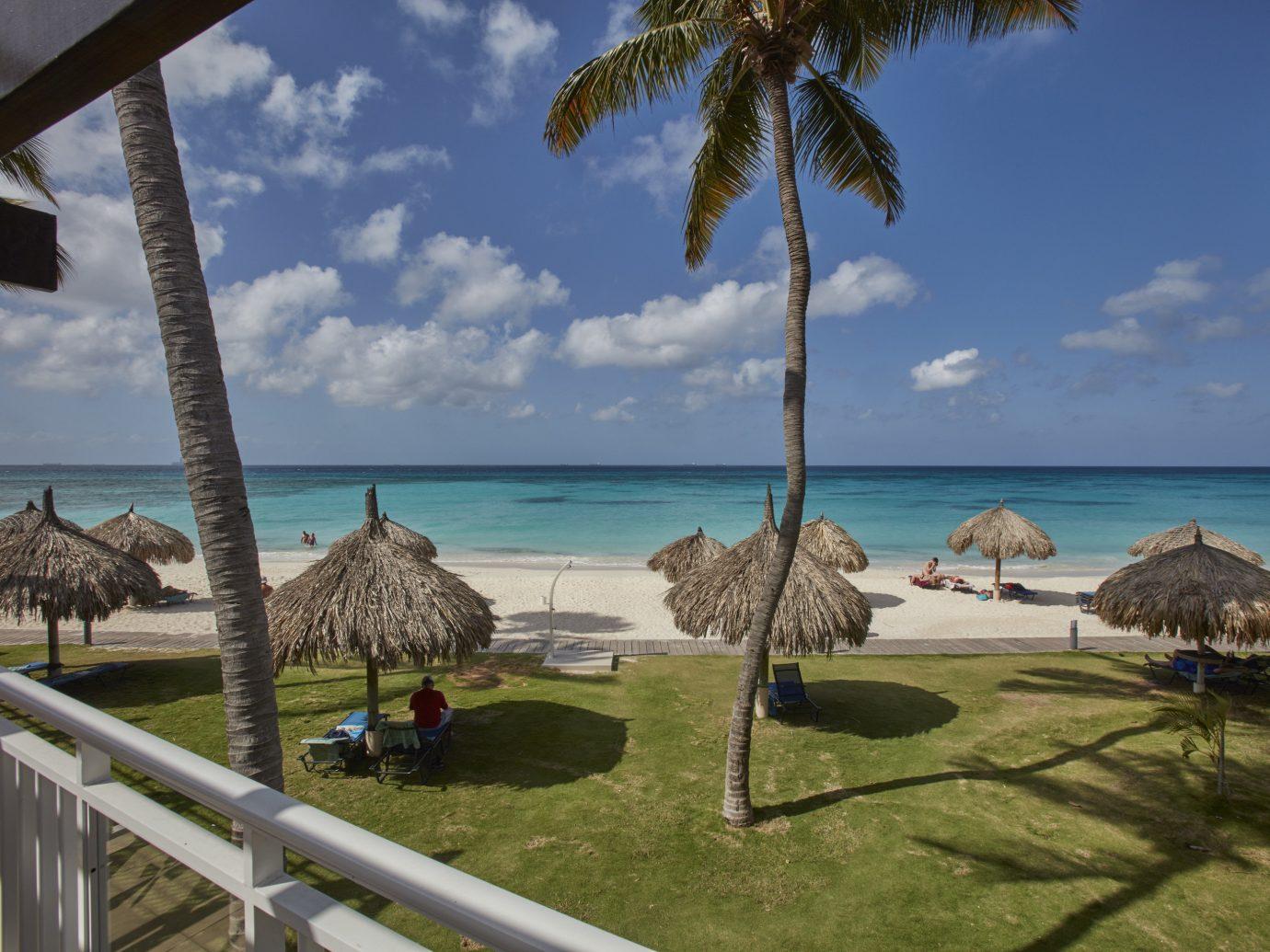 Hotels sky outdoor grass tree leisure vacation Beach Ocean Sea caribbean estate arecales Resort tourism Coast bay tropics Villa plant palm shore shade