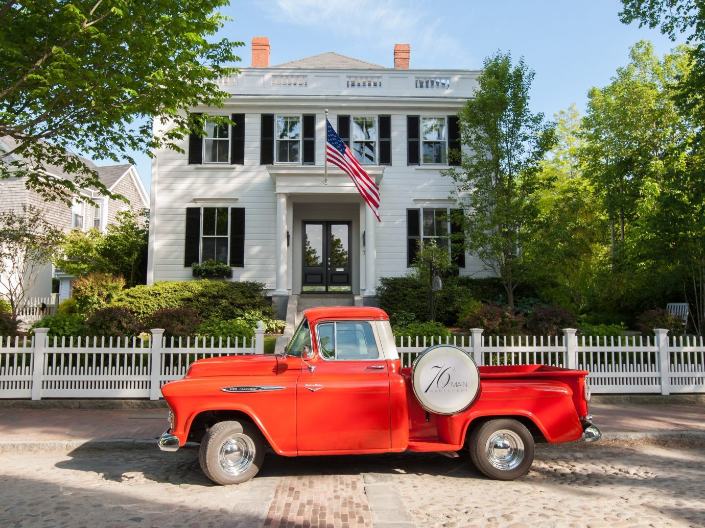 Trip Ideas tree outdoor car vehicle land vehicle red house city car antique car vintage car automobile make pickup truck parked truck jeep orange curb