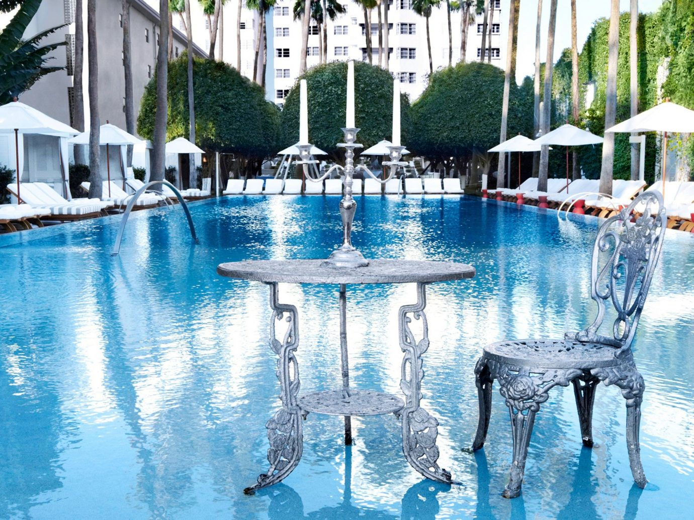Hotels tree water swimming pool outdoor leisure reflecting pool Resort water feature reflection estate backyard swimming