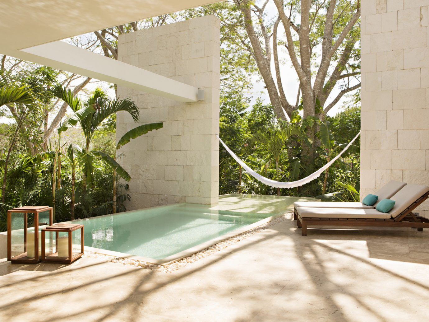 calm Greenery hammock Hotels lounge chairs Luxury open-air outdoor pool Patio Pool private private pool remote serene sophisticated Terrace trees Tropical tree leisure Architecture house Courtyard estate swimming pool home backyard interior design Villa Garden stone furniture