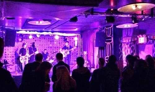 Food + Drink person indoor wine ceiling nightclub standing disco people stage music venue club group Bar crowd