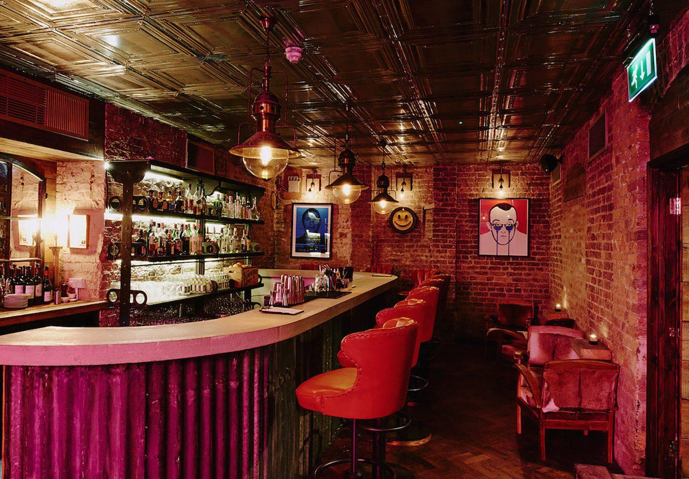 Boutique Hotels Hotels indoor red ceiling chair Bar restaurant interior design pub tavern café furniture