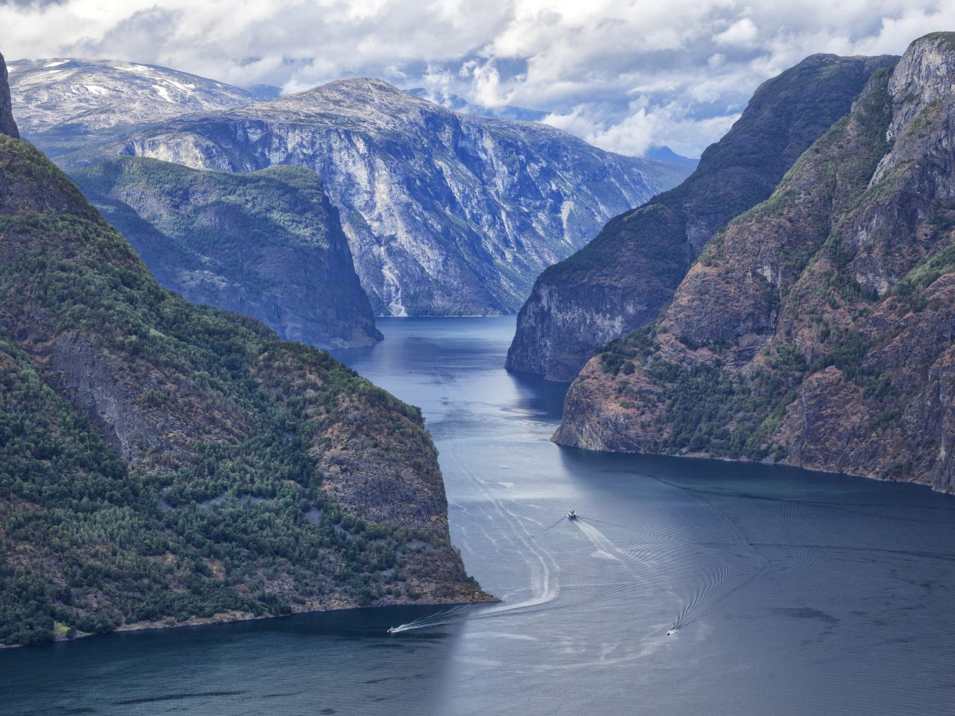 Editors Picks Luxury Travel Trip Ideas mountain Nature outdoor water valley canyon fjord Coast highland glacial landform promontory cliff mount scenery terrain fell sky national park background bay escarpment cape sound River hillside surrounded traveling beautiful Island ravine