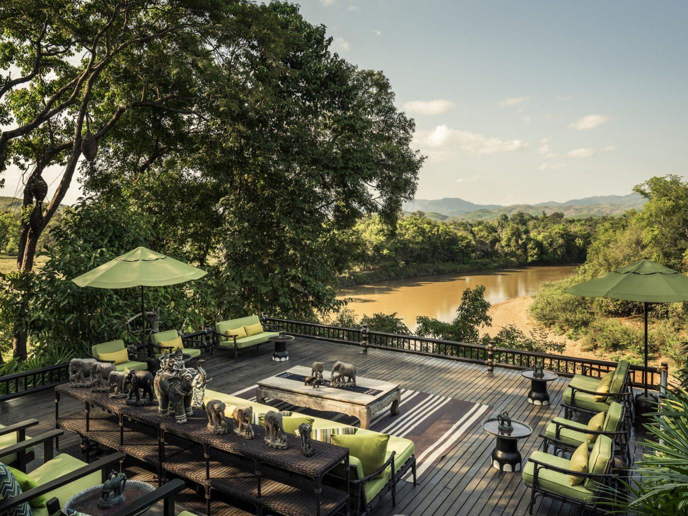 Luxury Travel Trip Ideas tree outdoor estate residential area park mansion Resort screenshot Jungle lined Garden furniture several