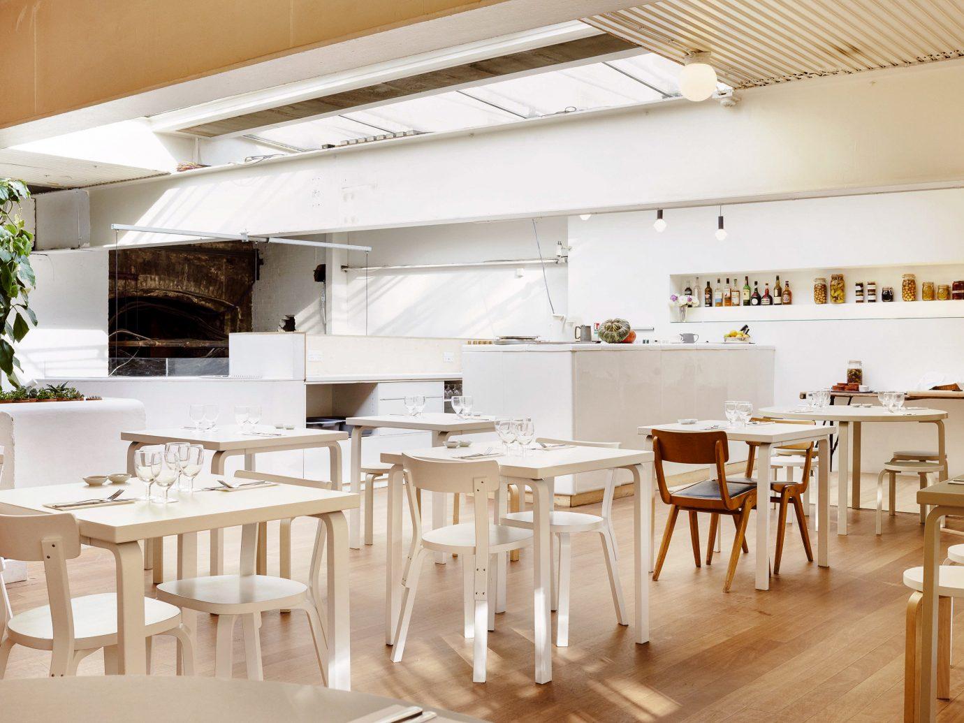 Food + Drink London floor indoor table ceiling chair room Dining interior design furniture restaurant wooden product design café interior designer loft wood area