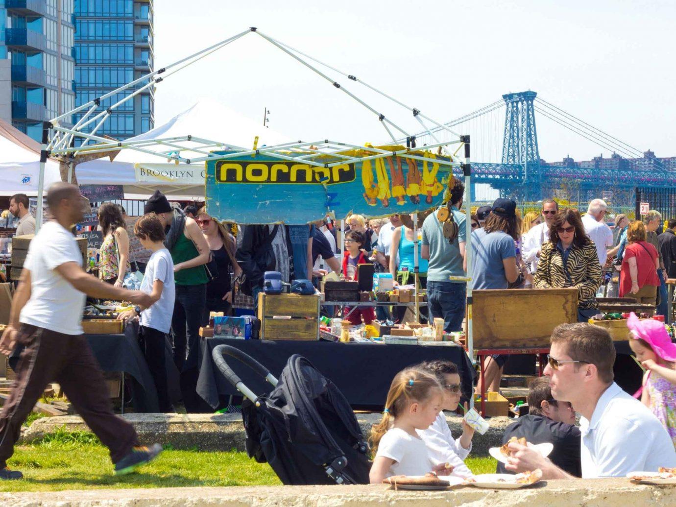Trip Ideas person outdoor fair public space vendor market people festival group
