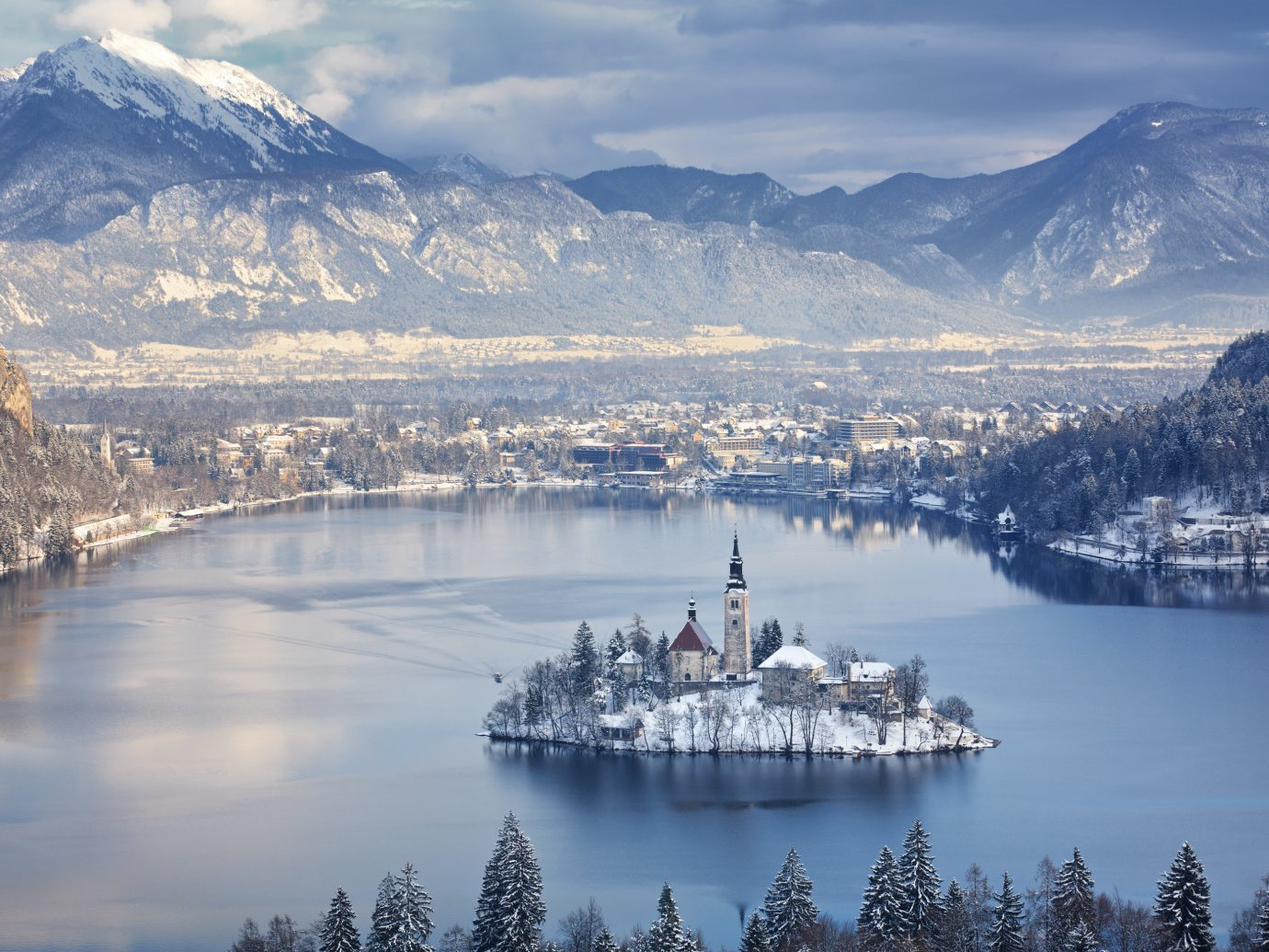 Mountains + Skiing Trip Ideas mountain sky outdoor water Nature reflection Winter mountainous landforms Lake mountain range cloud snow morning tree daytime freezing mount scenery City alps landscape River Sea tourist attraction glacial landform fell loch fjord arctic calm inlet