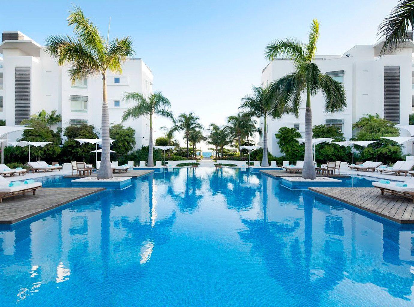 Hotels Trip Ideas outdoor sky tree Pool swimming pool Resort property leisure condominium estate vacation reflecting pool resort town Villa real estate backyard blue swimming several