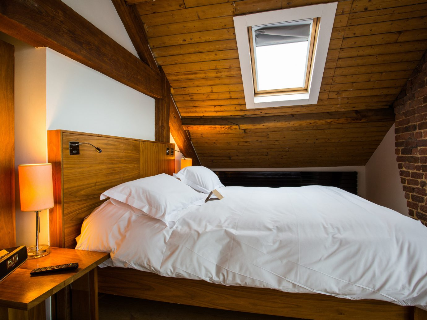 Trip Ideas indoor bed wall room Bedroom furniture wood ceiling Suite house white home interior design daylighting hotel