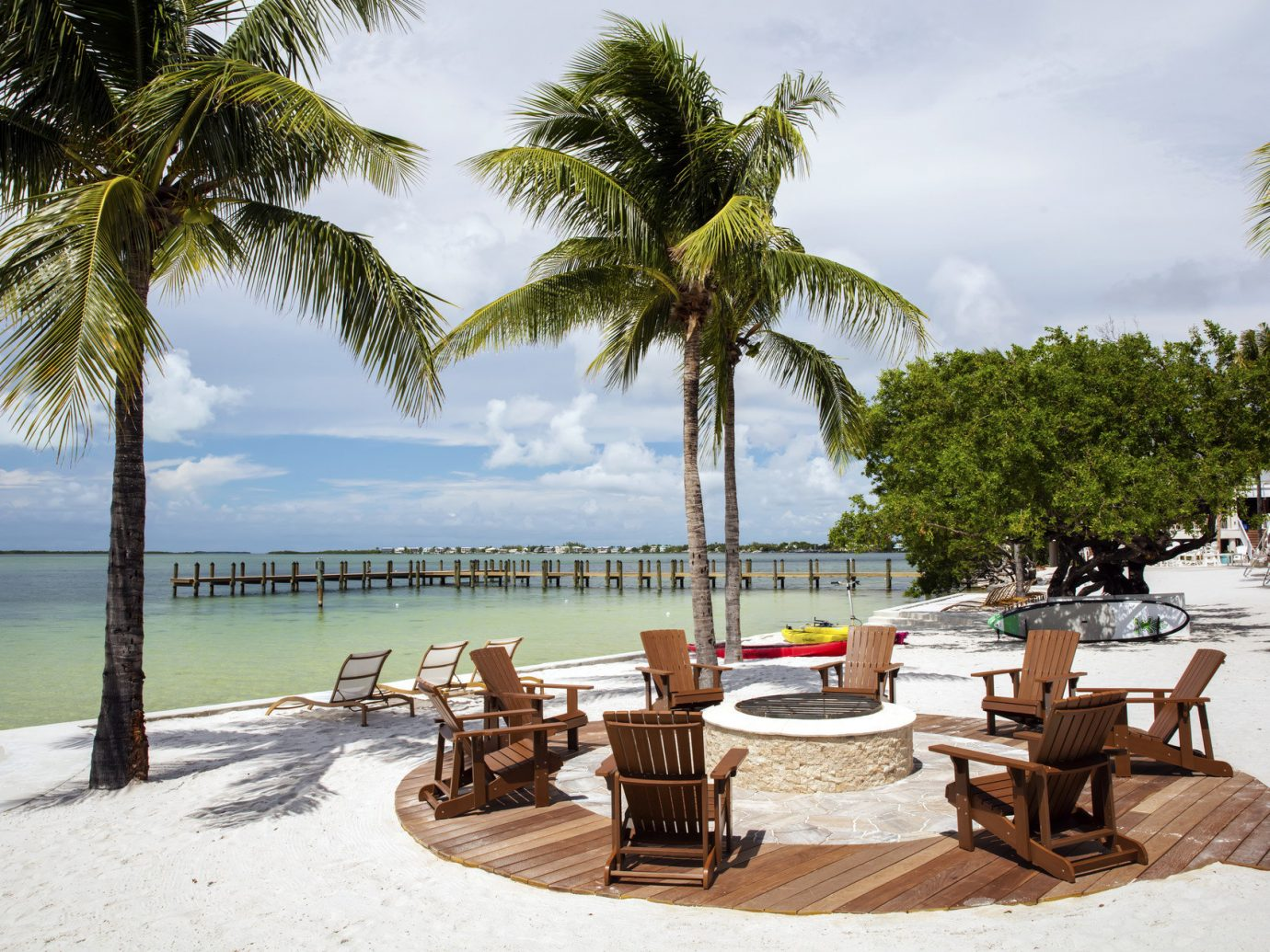 Trip Ideas tree outdoor ground Beach water chair plant palm vacation Resort caribbean arecales estate Sea palm family bay swimming pool Villa sandy lined furniture shade several