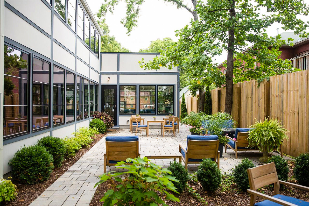 Trip Ideas Weekend Getaways tree outdoor Courtyard Garden Architecture real estate backyard mixed use house yard home plant Patio outdoor structure landscaping condominium facade roof stone