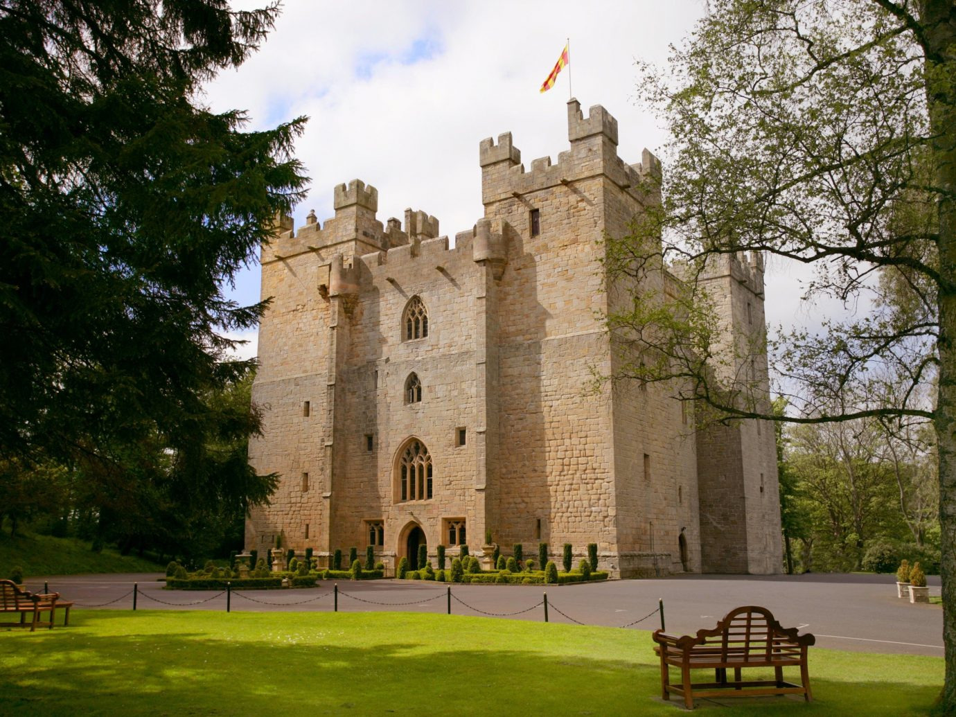 Hotels tree grass outdoor park building tower château stately home castle estate water castle old monastery abbey stone walkway