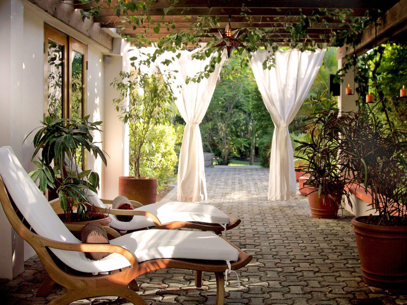 Lounge chairs on a patio at Ka'ana Resort, San Ignacio, Belize