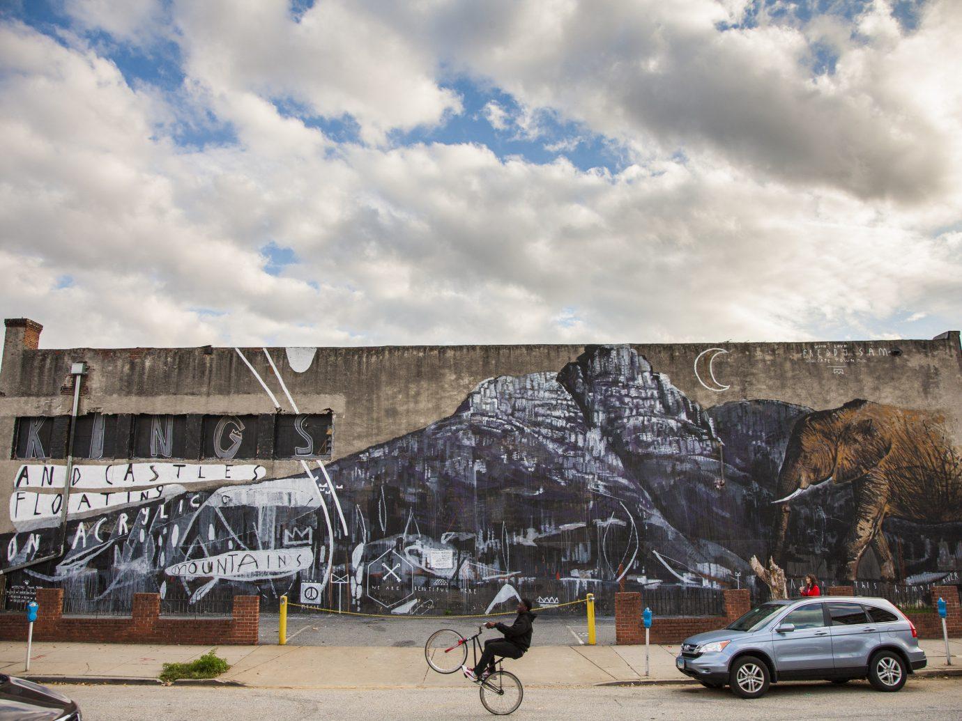 Romance Trip Ideas Weekend Getaways outdoor sky road wall parked street art mural building cloud neighbourhood vehicle facade car tree street house graffiti City day