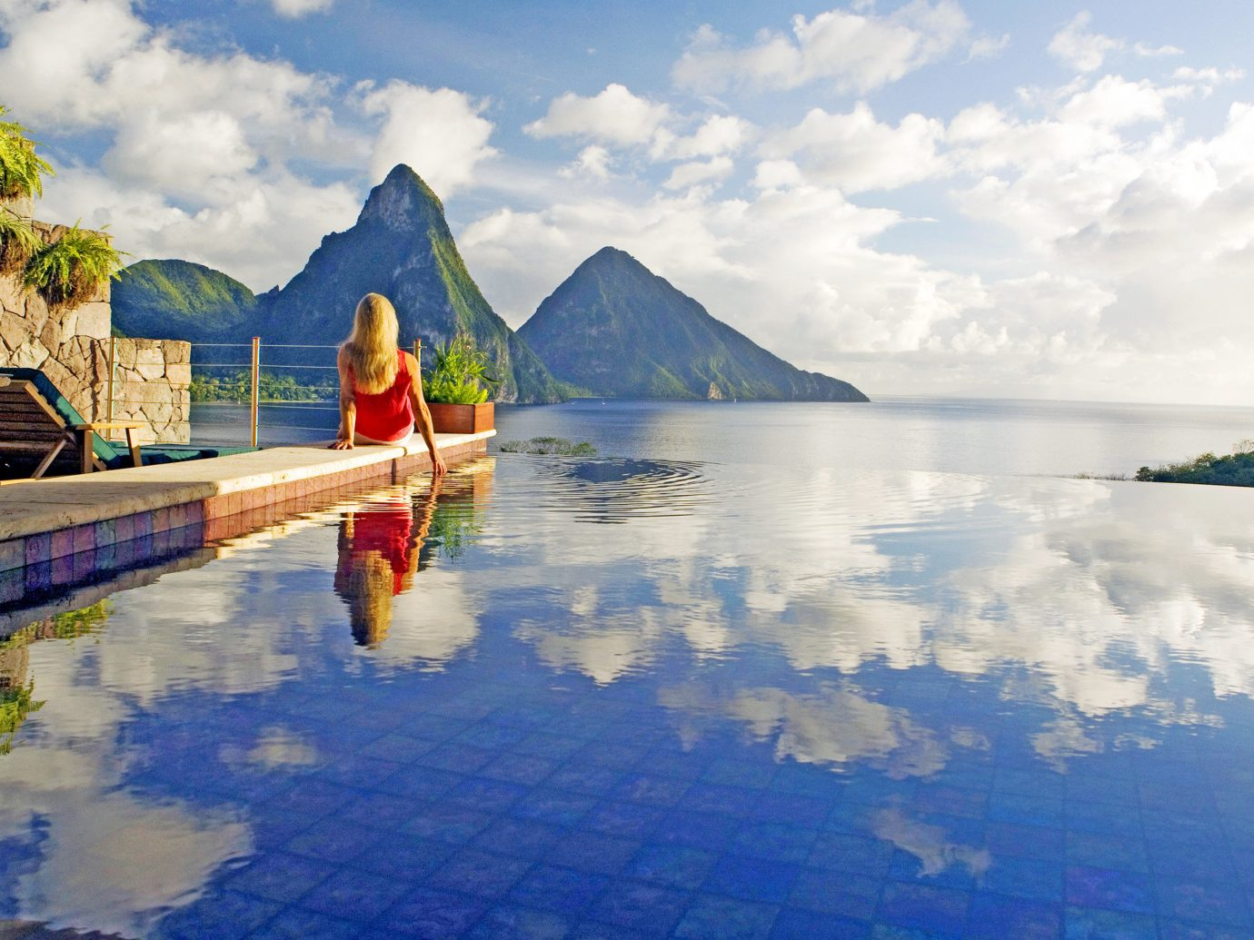 Hotels Luxury Travel sky outdoor Nature leisure mountain water reflection tourism vacation cloud swimming pool Sea landscape recreation Lake tropics Resort