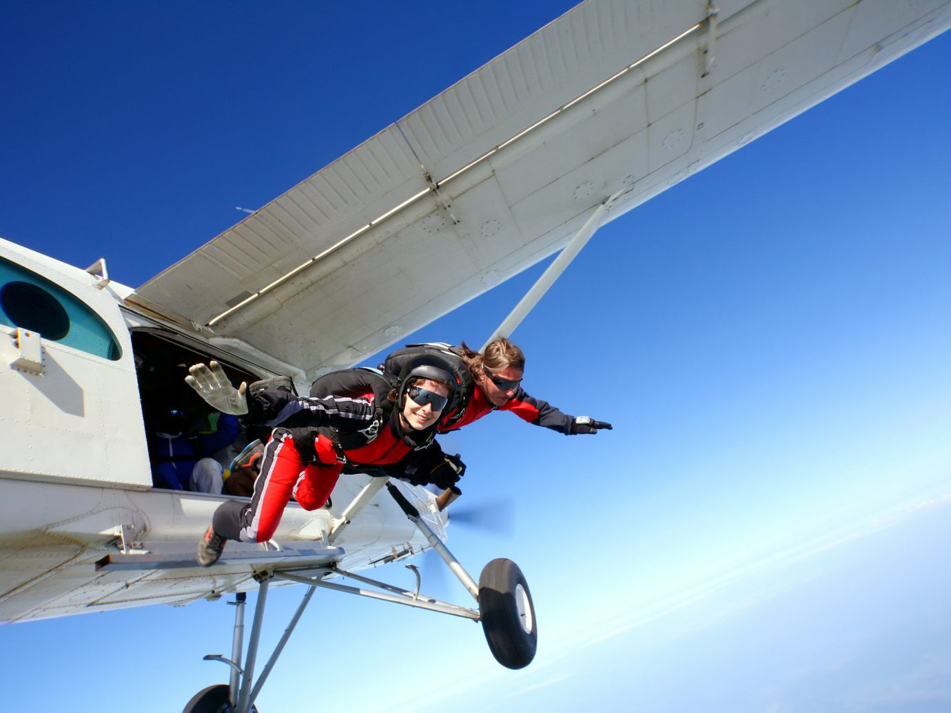 Offbeat sky plane outdoor air sports skiing air travel airplane flight parachuting ultralight aviation aircraft aviation windsports atmosphere of earth sports gliding jet aerospace engineering aerobatics extreme sport wing Adventure air force general aviation engine