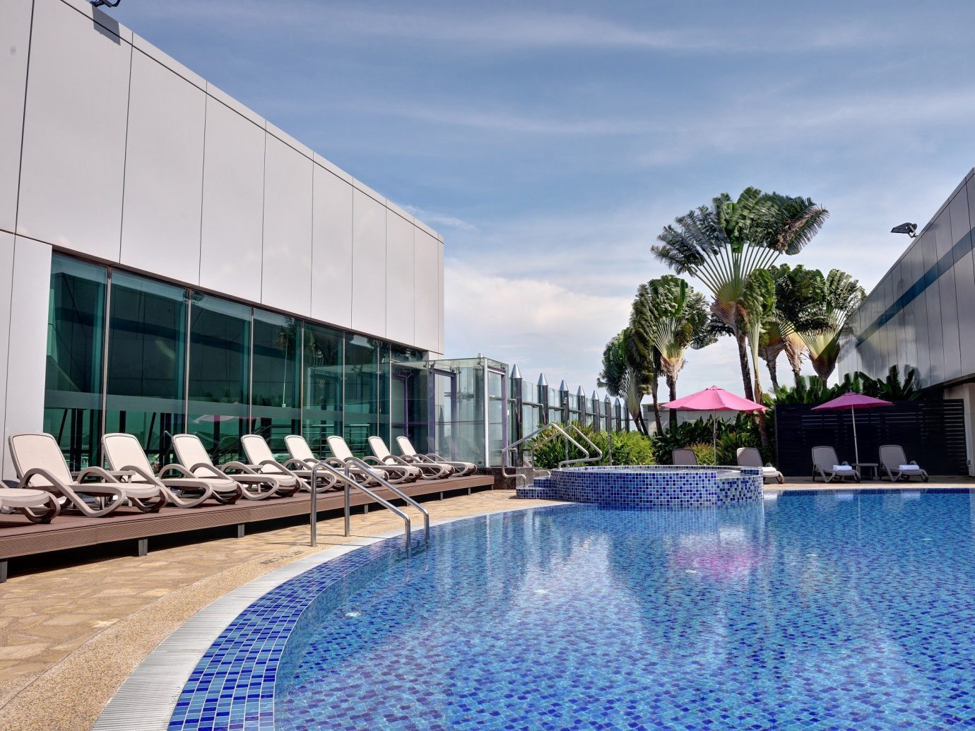 Food + Drink sky outdoor swimming pool leisure property building Pool leisure centre Resort condominium estate reflecting pool facade real estate convention center swimming