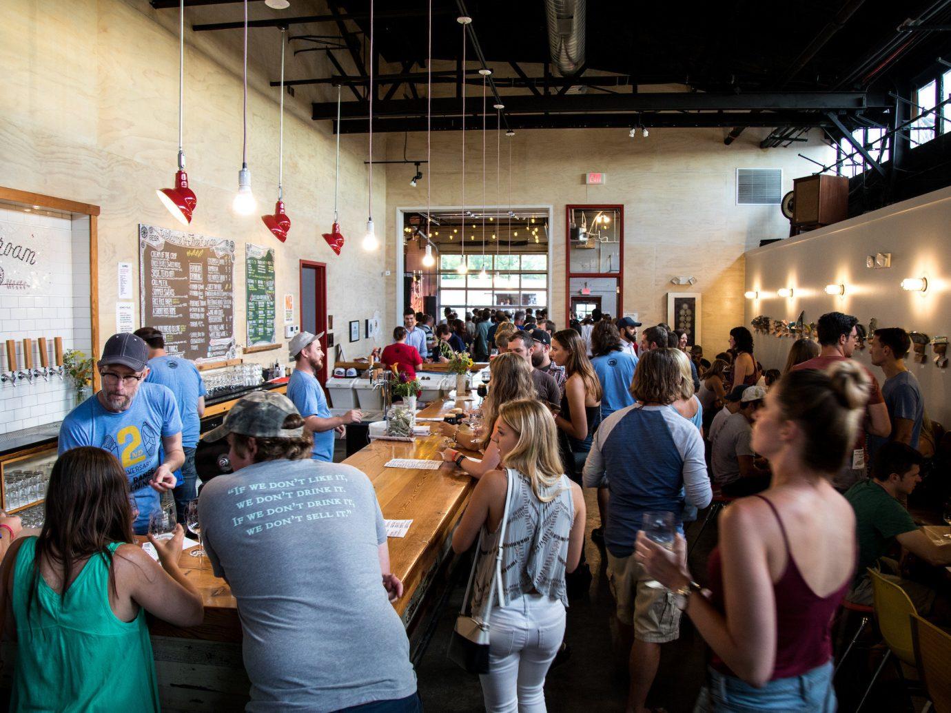 Trip Ideas person indoor ceiling people group scene restaurant Drink crowd