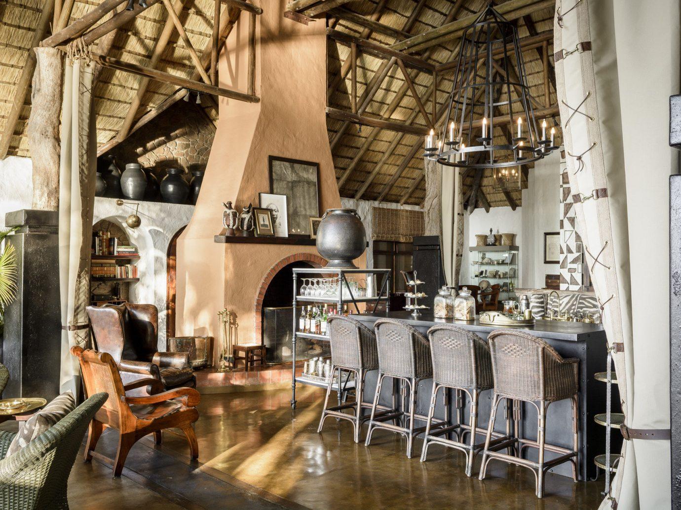 Food + Drink indoor floor room restaurant estate interior design meal Boutique area furniture several