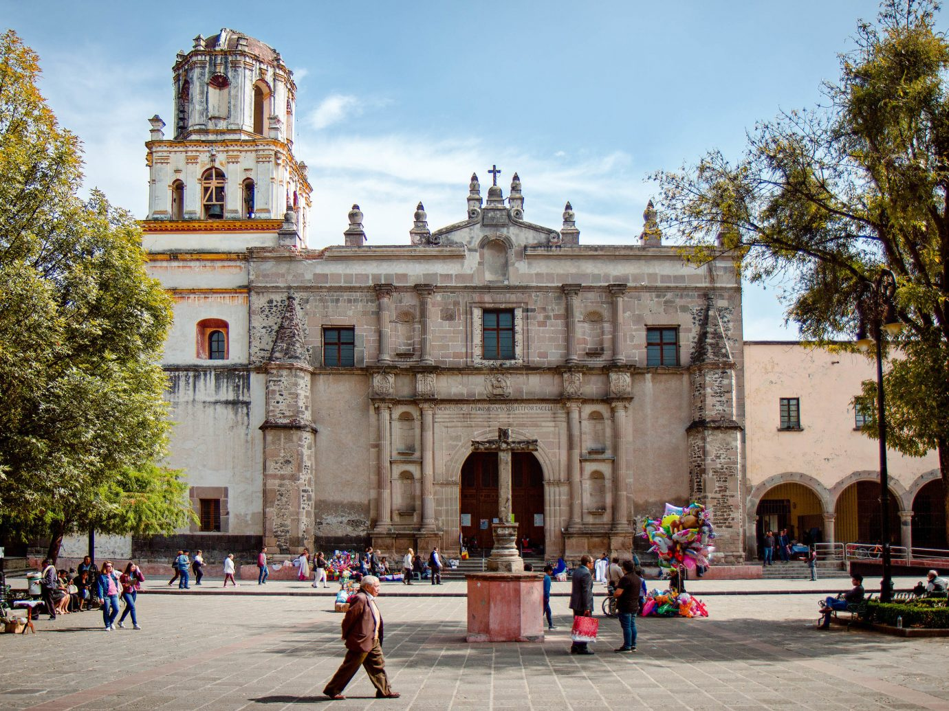 Mexico City Trip Ideas tree outdoor sky road plaza landmark town square Town building City tourist attraction palace cathedral Church basilica people place of worship tourism metropolitan area facade estate metropolis plant abbey stone square government building