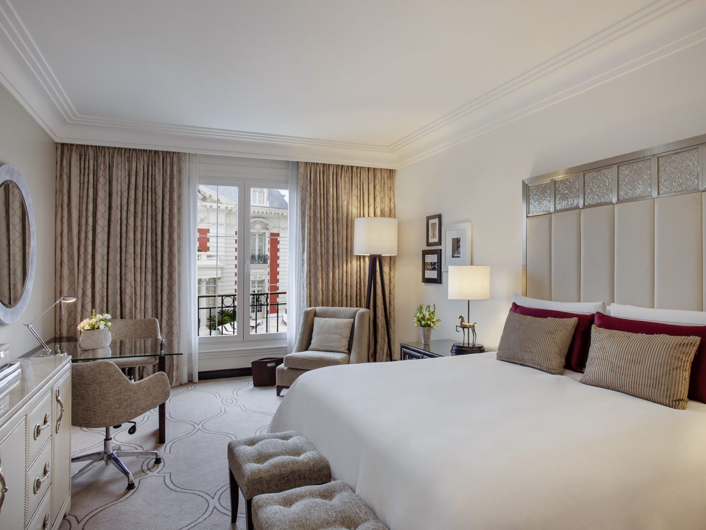 Boutique Hotels Luxury Travel indoor wall room sofa bed property interior design Suite ceiling Bedroom living room scene real estate window treatment window home hotel estate interior designer window covering apartment curtain furniture decorated
