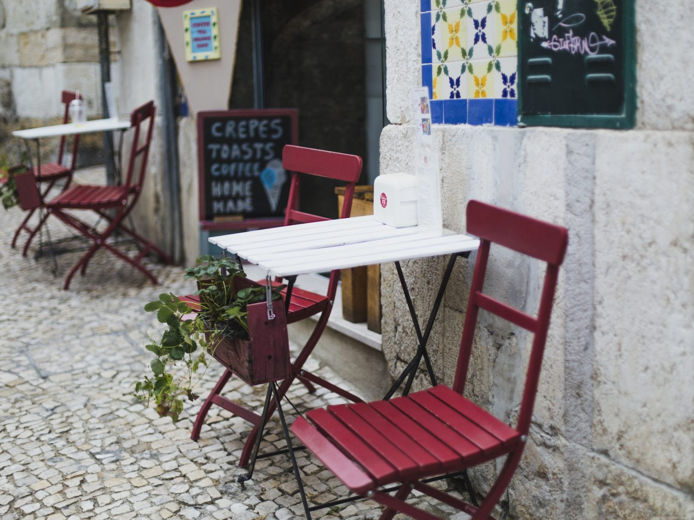 Lisbon Portugal Trip Ideas furniture chair table street
